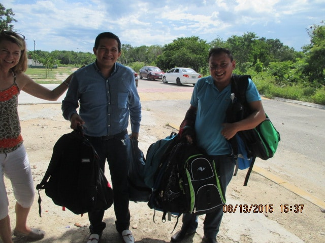 Director Arturo loaded down with backpacks and snorkel gear donation.